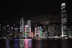 Hong Kong skyline at night with Star ferry Royalty Free Stock Images