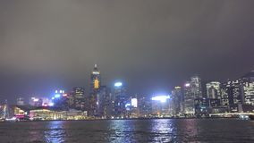 View of Hong Kong skyline at night from star ferry stock video footage