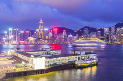 Hong Kong skyline and pier at twilight Royalty Free Stock Image