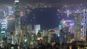 Hong Kong skyline urban panorama at night time lapse China. zoom out