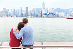 Hong Kong skyline and Victoria harbour - couple Royalty Free Stock Photo