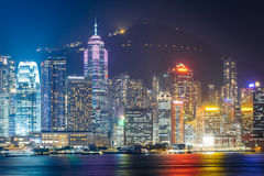 The Hong Kong skyline and Victoria Peak at night, seen from Tsim Royalty Free Stock Photos