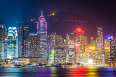 The Hong Kong skyline and Victoria Peak at night, seen from Tsim Stock Photography