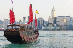 Hong Kong skylines and junk boat. In the daytime royalty free stock photo