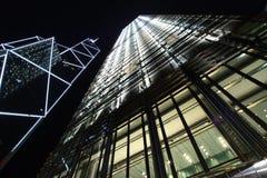 Hong Kong skyscrapers. Low angle view of skyscrapers on Hong Kong island illuminated at night, Hong Kong Stock Images