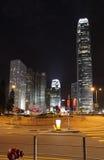 Hong Kong skyskrapor vid natt med mitten för internationell finans en och två Royaltyfria Foton