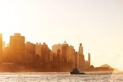 Hong Kong-stad in zonsondergangtijd stock afbeelding