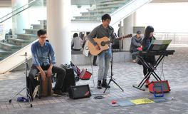 Hong Kong street performer. December 25, 2013 - street performer singer songs, located in Tsim Sha Tsui, Hong Kong Royalty Free Stock Photography