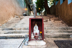 Hong Kong street shrine containing statue of Guanyin Royalty Free Stock Photo