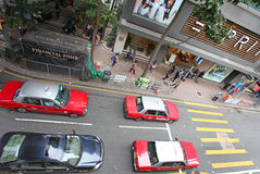 Hong Kong street traffic with red taxi Royalty Free Stock Image