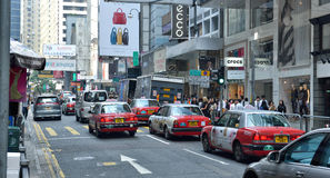 Hong Kong Street View. Cars speeding in Central, the downtown area of Hong Kong Stock Image