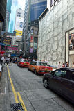 Hong Kong Street View. Taxis going up a slope in Central, downtown area of Hong Kong Stock Image