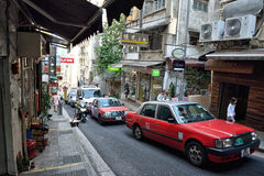 Hong Kong Street View. Taxis going up a slope in Central, downtown area of Hong Kong Stock Images