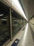 Hong Kong Subway (MTR). A train arrives at Yau Ma Tei Station on Hong Kong's Mass Transit Railway stock photography