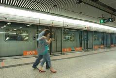 Hong Kong Subway (MTR). A train arrives at Admiralty Station on Hong Kong's Mass Transit Railway Stock Images