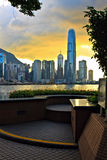 Hong Kong sunset. Skyline with trees silhouette and flowerbed in the front Royalty Free Stock Photos