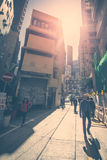 Hong Kong sunset cityscape view with walking people Royalty Free Stock Photos