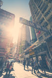 Hong Kong sunset cityscape view with walking people Stock Photos