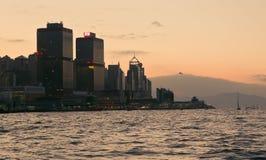 Hong Kong, China - Nov 27, 2017: Hong Kong embankment during sunset. Helicopter is flaying to Hong Kong during sunset Royalty Free Stock Photos