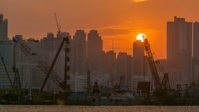 Hong Kong Sunset, visión desde el timelapse céntrico de la bahía de Kowloon metrajes