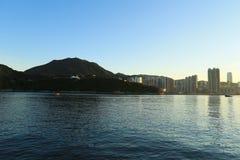 Hong Kong Sunset, Yau Tong Lei Yue Mun water bay and lighthouse Stock Images