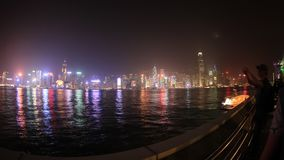 Hong Kong Symphony of lights. Hong Kong, China - December 1, 2016: skyline time lapse from Tsim Sha Tsui waterfront in Kowloon, during the show Symphony of stock video