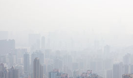 Hong kong tall buildings in haze. At day Royalty Free Stock Photos
