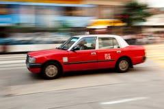 Hong Kong Taxi. A motion blur image of a taxi in Hong Kong Royalty Free Stock Photography