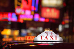 Hong Kong Taxi. Taxi Sign in Hong Kong Royalty Free Stock Photography