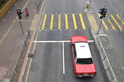 Hong Kong Taxi in Front of Traffic Light Stock Photo