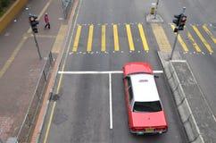 Hong Kong Taxi in Front of Traffic Light. Photo was taken at Shek Kip Mei, Hong Kong Stock Photo