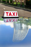 Hong Kong taxi and IFC reflection Stock Image