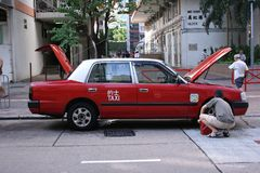 Hong Kong Taxi maintenance Royalty Free Stock Image