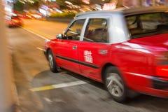 Hong Kong taxi moving Stock Photos