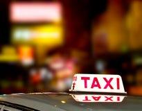 Hong Kong taxi sign 1. Taxi sign with Hong Kong city light Royalty Free Stock Image