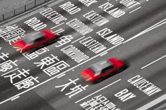 Hong Kong Taxis. Red Hong Kong Taxis on a busy interchange in Causeway Bay Royalty Free Stock Image