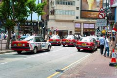 Hong Kong Times Square Taxi. Located at Causeway Bay, Hong Kong, this picture was taken right outside of Times Square, where only taxis are allowed to use the stock photo