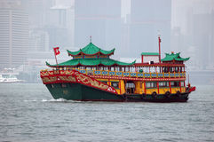 Hong Kong tourist's ferry. Ferry in traditional Chinese style for tourists, who visited Hong Kong harbour Stock Photo