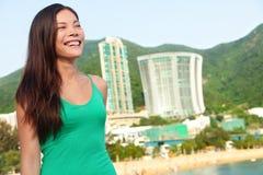 Hong Kong tourist woman at Repulse Bay beach. Beautiful Asian woman in summer dress enjoying view. Hong Kong lifestyle image Royalty Free Stock Photo