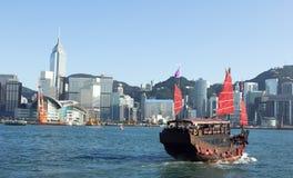 Hong Kong and Tourists Junk. Landmark of Hong Kong buildings and tourists junk Royalty Free Stock Photos
