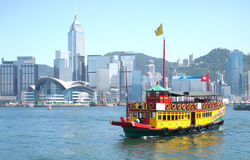 Hong Kong and Tourists Junk Boat. Landmark of Hong Kong buildings and tourists junk boat royalty free stock photos