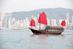 Hong Kong. Traditional wooden sailboat sailing in victoria harbor,Hong Kong Stock Images