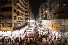 Hong Kong Traffic. At night the streets in Hong Kong are still alive, packed with people. This is Mong Kok, the most crowded area in the world Royalty Free Stock Image
