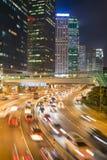 Hong Kong trafik på natten Royaltyfri Bild