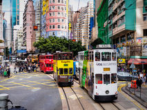 Hong Kong Tramways 'Ding Ding' double-decker trams. A colorful street photo showing the double-decker trams on Hong Kong Island, locally known Royalty Free Stock Image