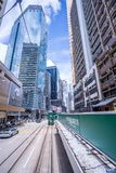 Hong Kong tramways, Hong Kong`s trams run in two directions -- east and west. Passengers lean back as a Hong Kong tram royalty free stock photo