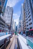 Hong Kong tramways, Hong Kong`s trams run in two directions -- east and west. Passengers lean back as a Hong Kong tram stock photo