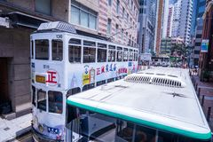 Hong Kong tramways, Hong Kong`s trams run in two directions -- east and west. Passengers lean back as a Hong Kong tram. Hong Kong,China - June 24,2018: Hong Kong royalty free stock photos