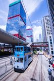 Hong Kong tramways, Hong Kong`s trams run in two directions -- east and west. Passengers lean back as a Hong Kong tram stock images