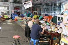 Hong Kong upptar protester som fördelas till Arkivbild